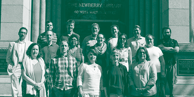 three rows of people smiling for a picture in front of the newberry library